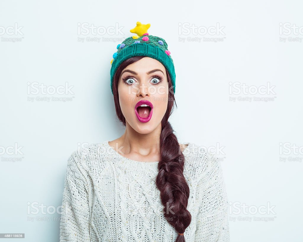 Surprised woman in winter outfit stock photo