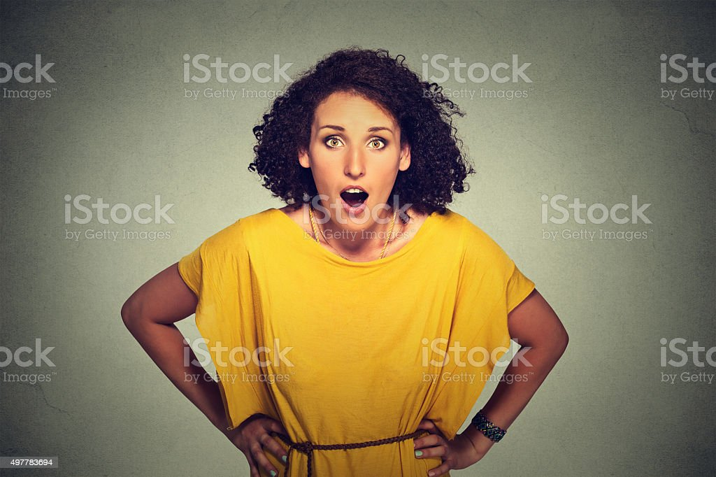 Surprised woman in yellow dress stock photo