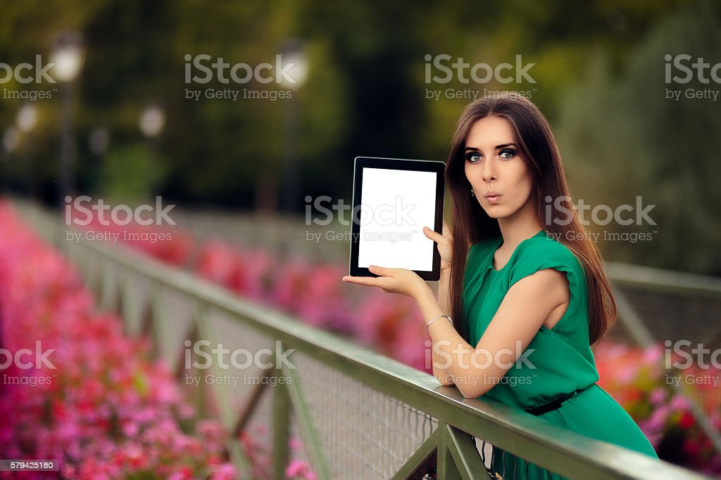 Surprised Woman Showing a Digital Tablet Display stock photo
