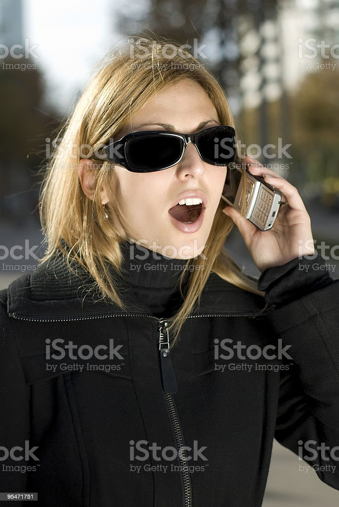Surprised woman speaking for the mobil stock photo