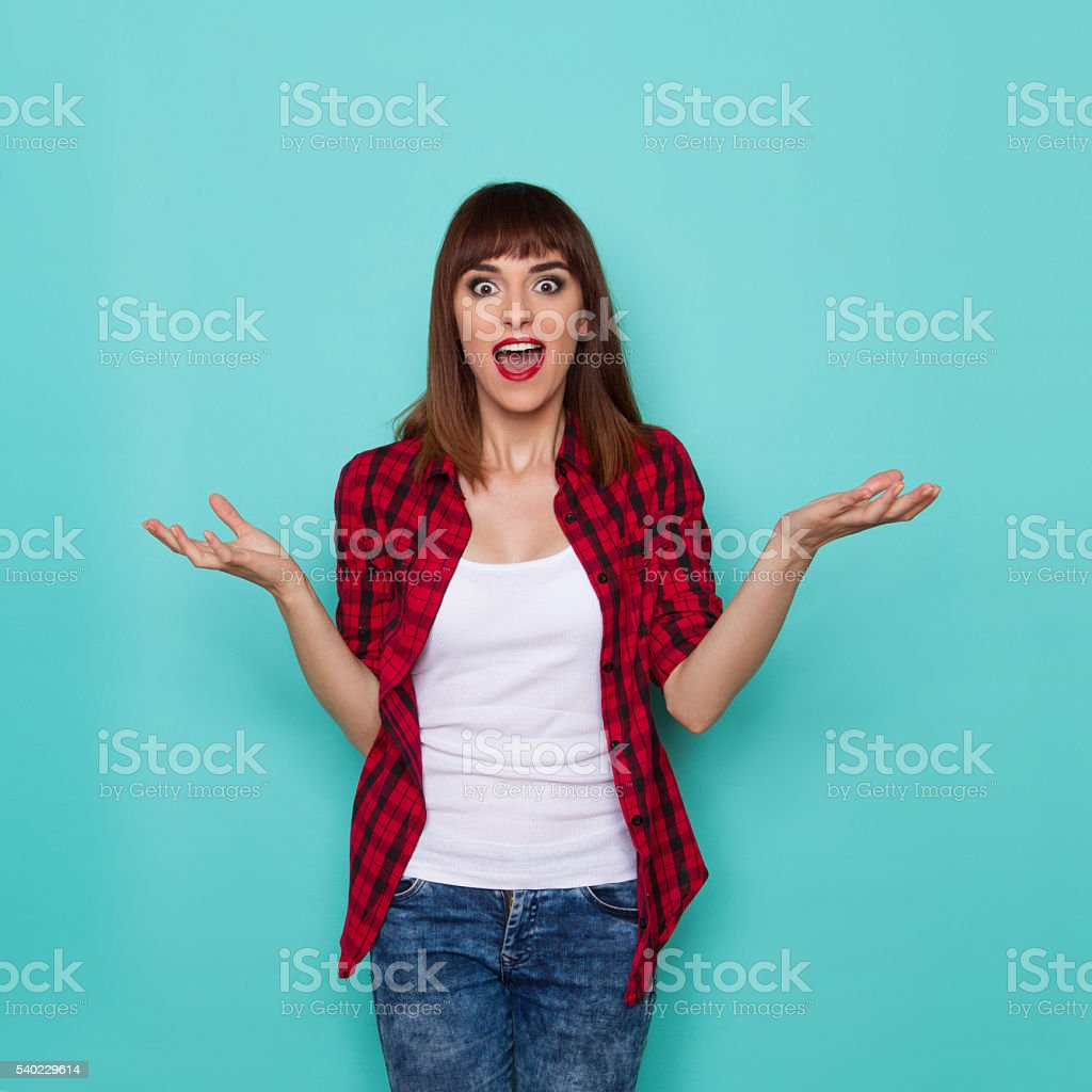 Surprised Woman With Arms Outstretched stock photo