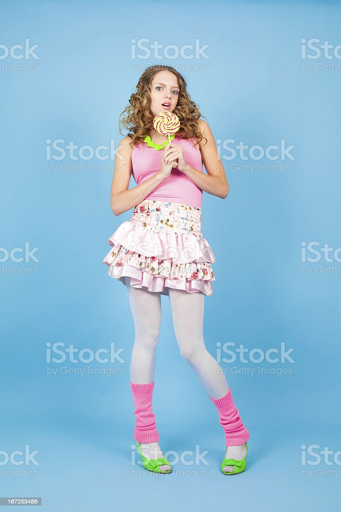 Surprised woman with colorful lollipop royalty-free stock photo