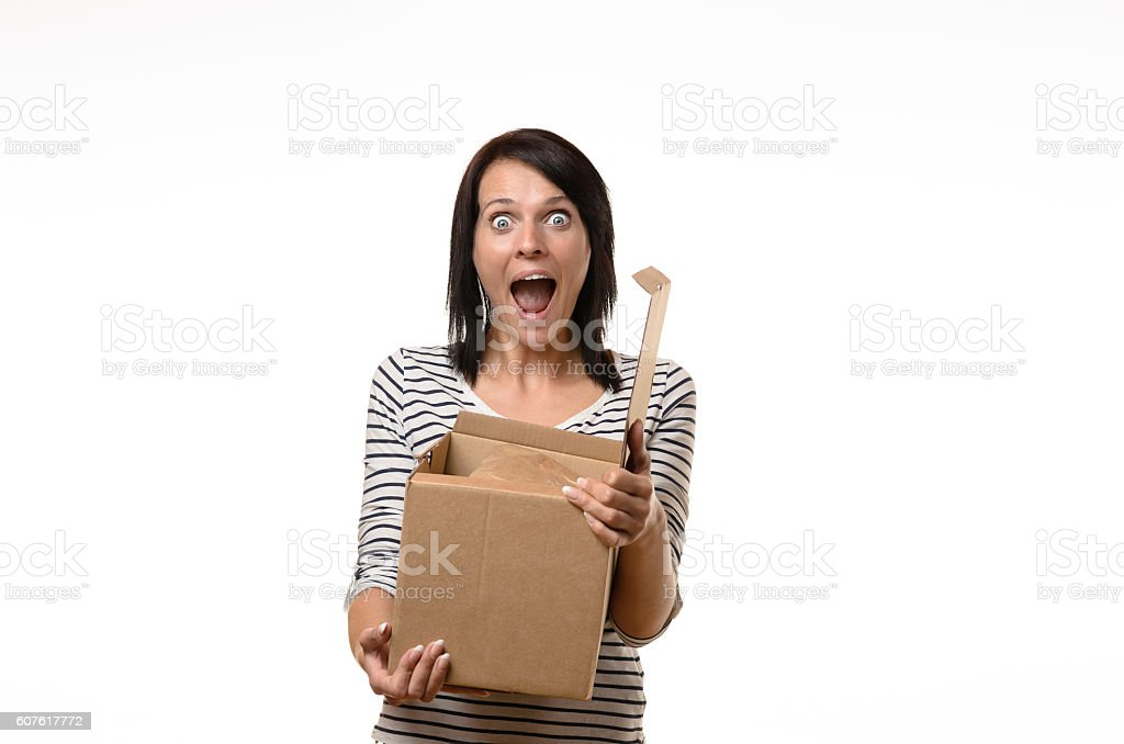 Surprised woman with open cardboard box stock photo