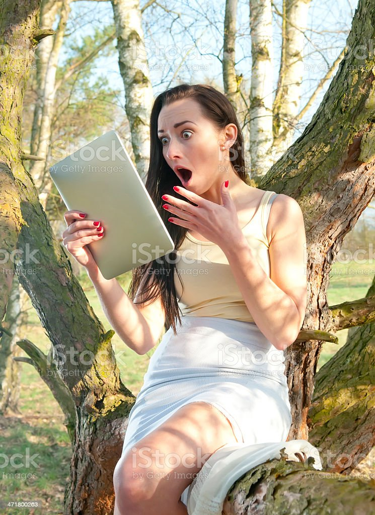 surprised woman with tablet pc royalty-free stock photo