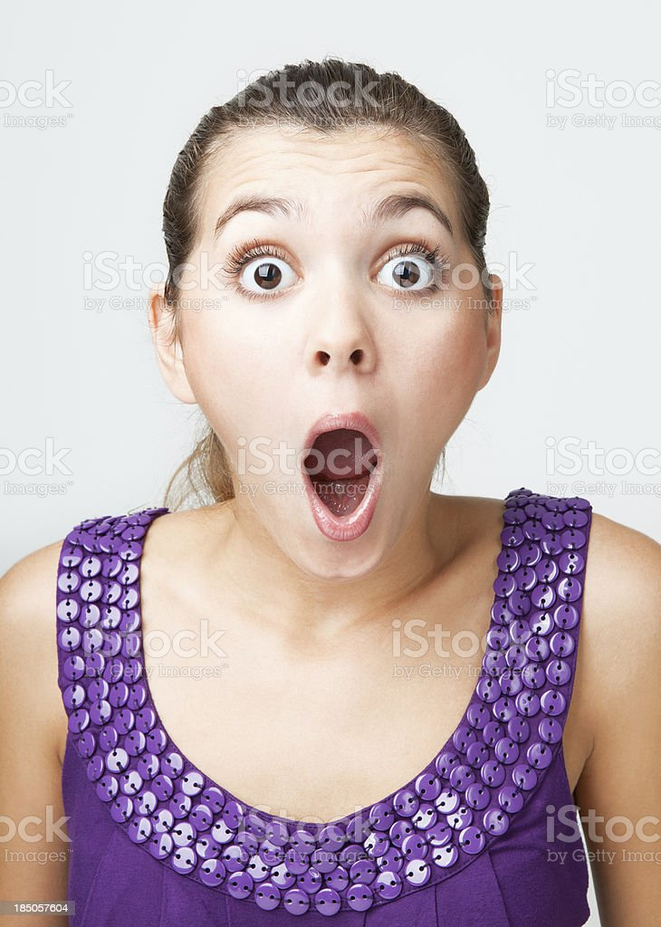 Surprised young girl stock photo