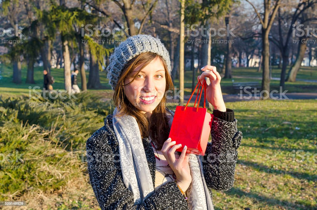 Surprised young girl posing with a red gift box royalty-free stock photo