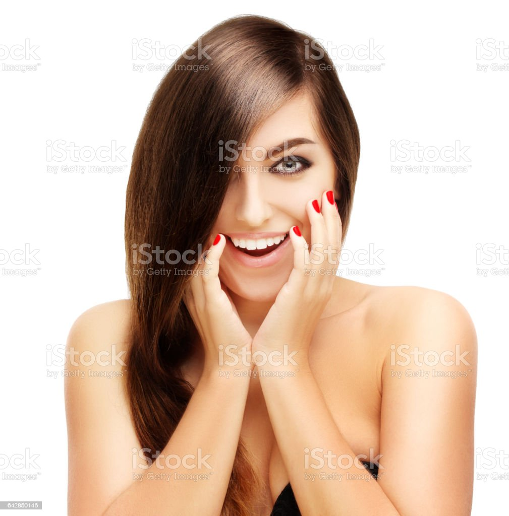 Surprised young girl with brown  hair stock photo