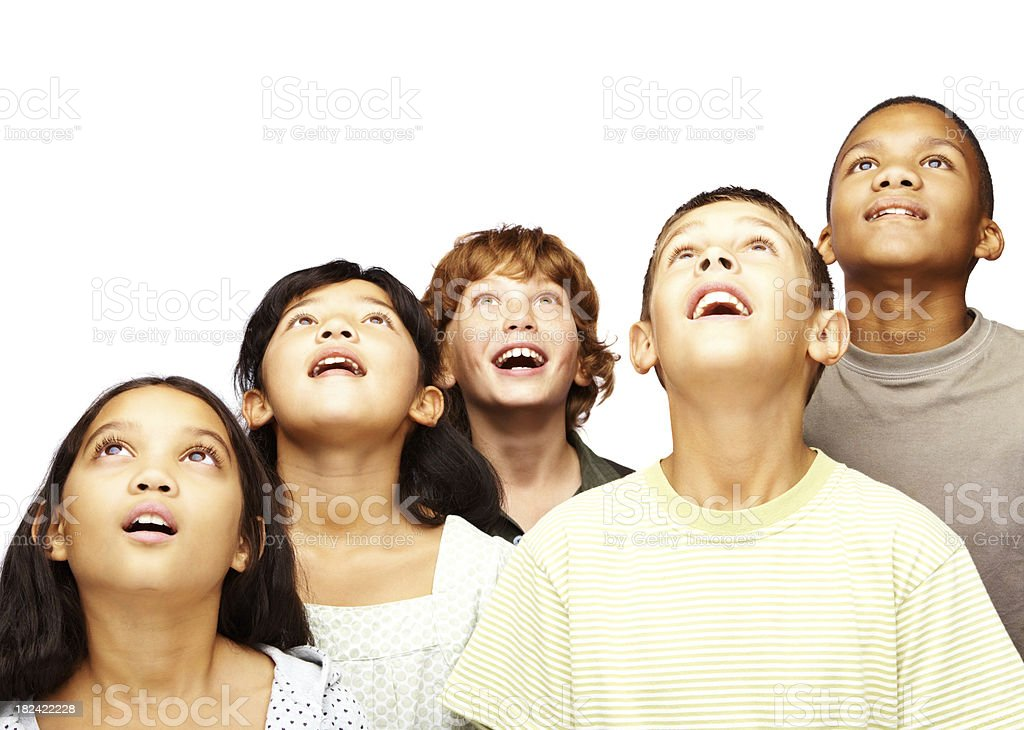Surprised young kids looking up stock photo
