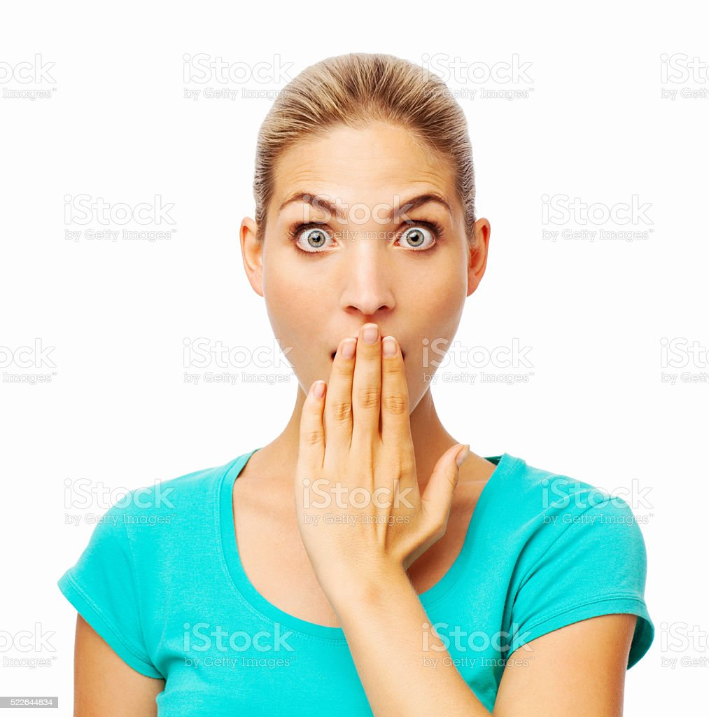 Surprised Young Woman Covering Mouth stock photo