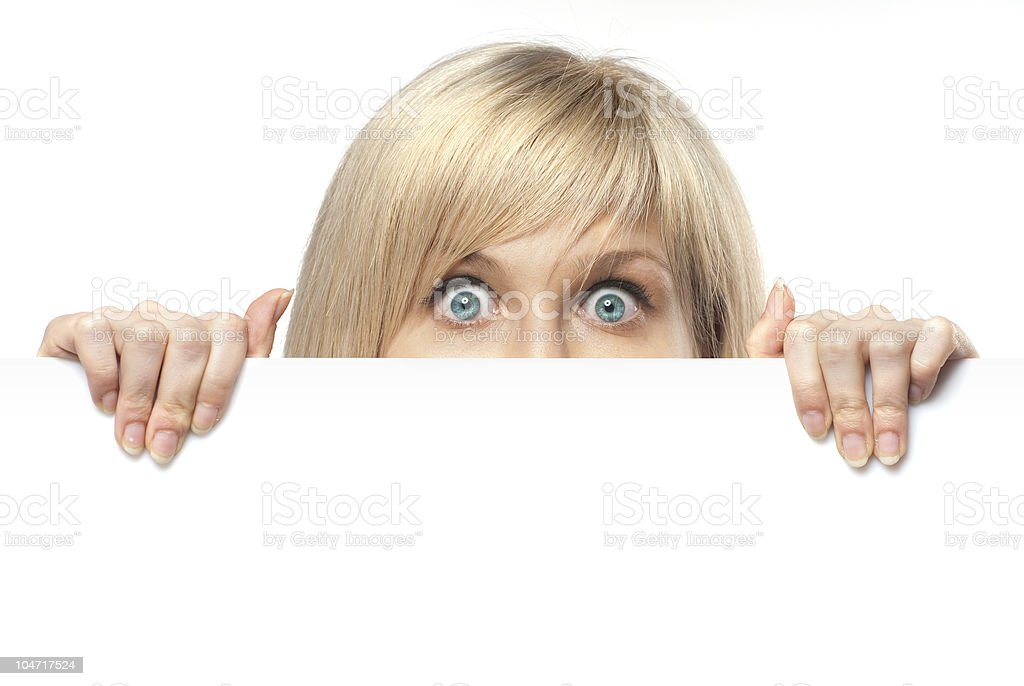 surprised young woman holding empty paper isolated on white stock photo
