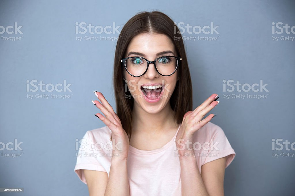 Surprised young woman in glasses stock photo
