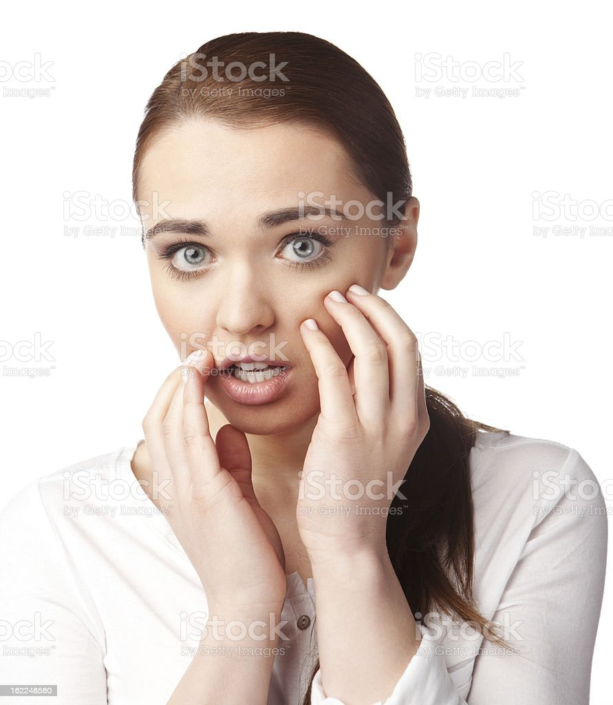 Surprised young woman looking at you stock photo