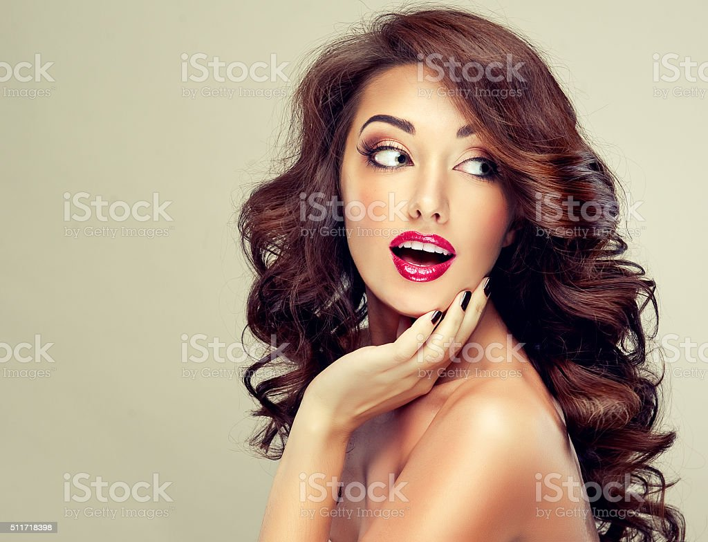 Surprised young woman. Luxury fashion style, stock photo