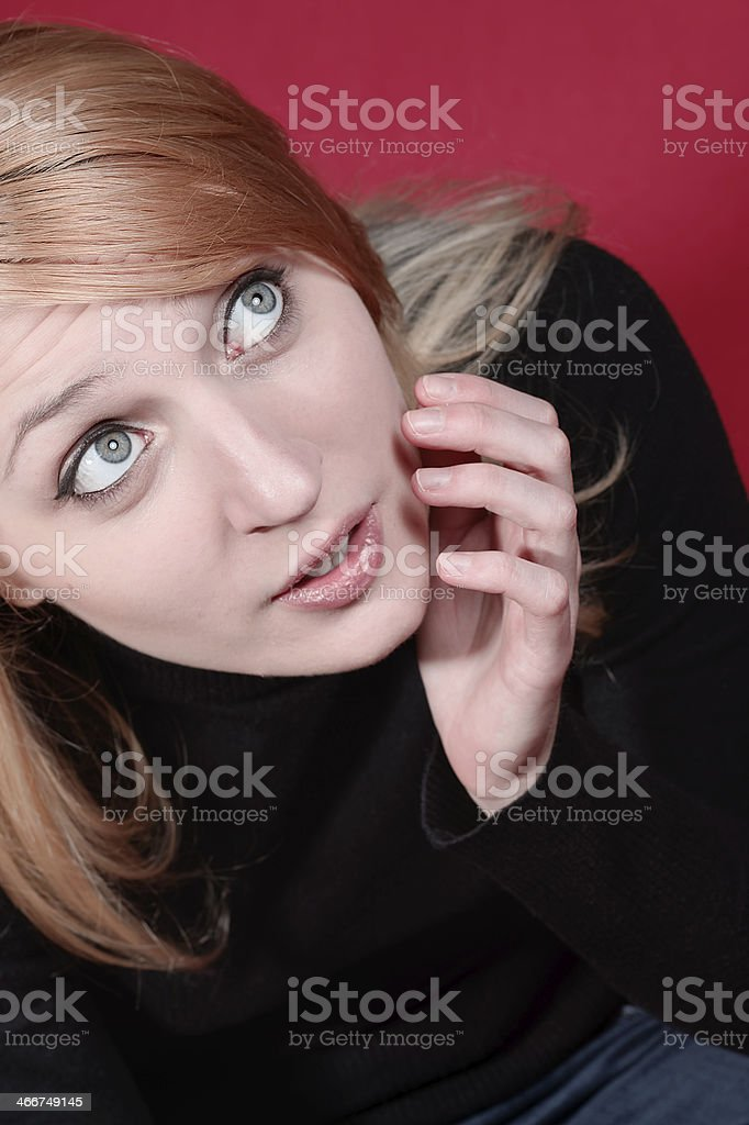 Surprised young woman photographed from above royalty-free stock photo