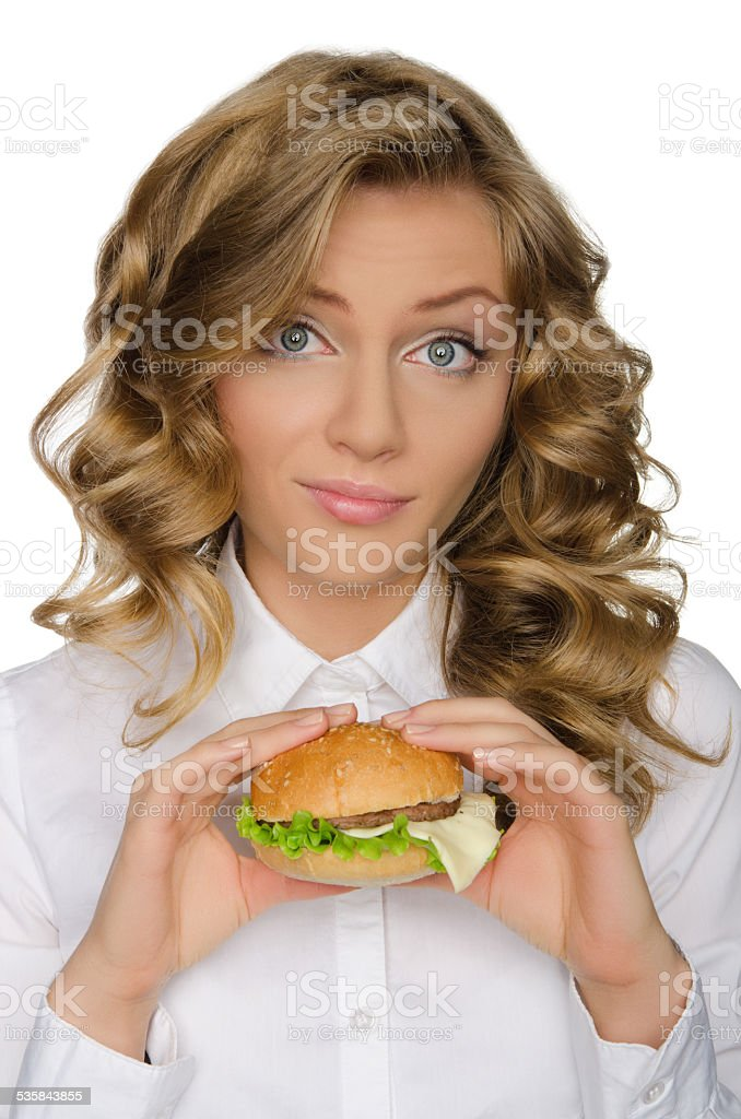 Surprised young woman with hamburger stock photo