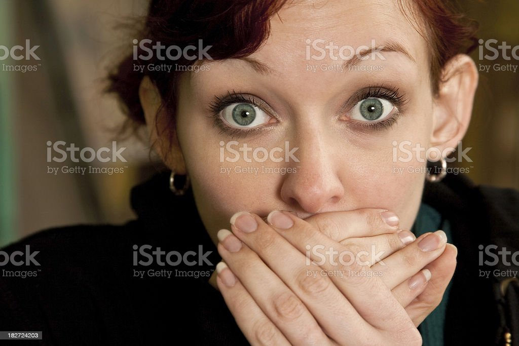 Surprised Young Woman With Hands Over Her Mouth royalty-free stock photo