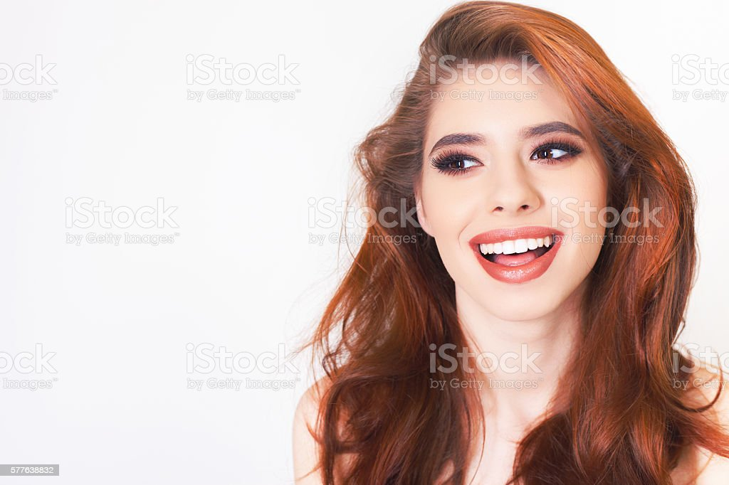 Surprised young woman with healthy perfect hair and white smile stock photo