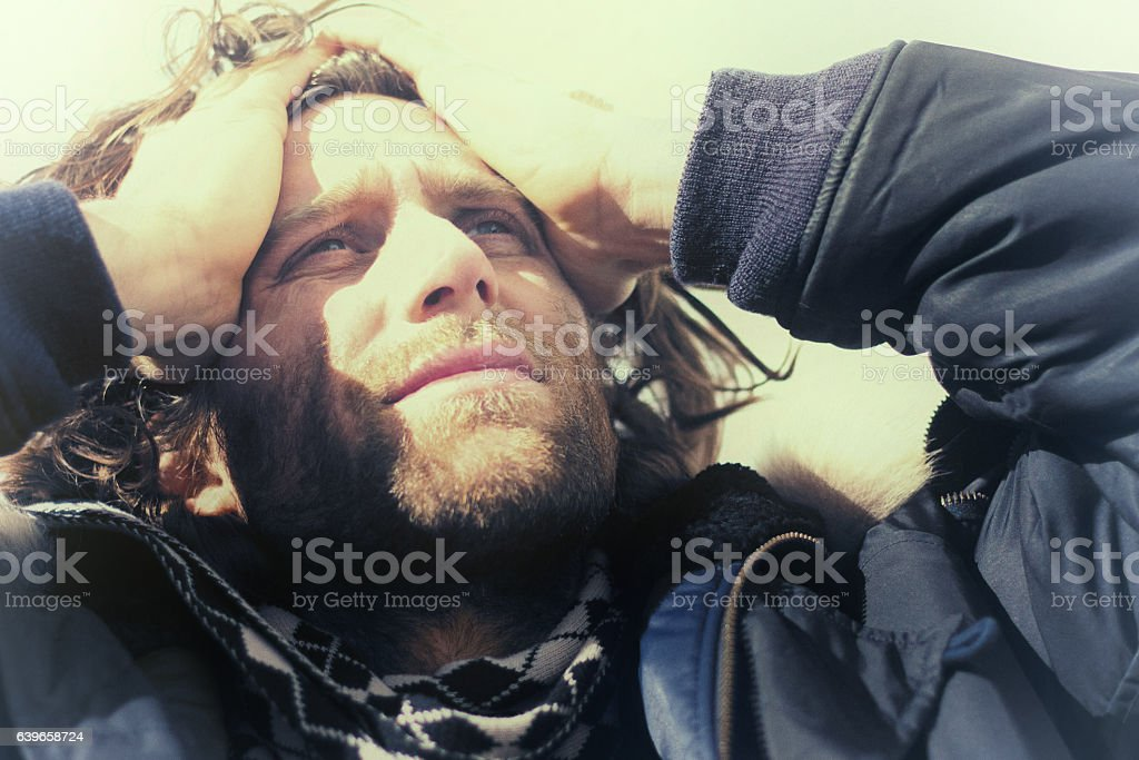 Surprised/Upset Young Man, Looking Up, with Hands on Head (Close-Up) stock photo