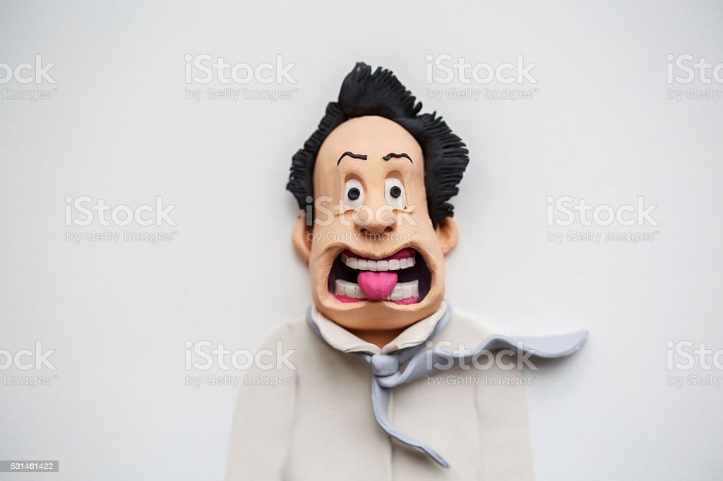 surprising expression, handmade clay figurine stock photo