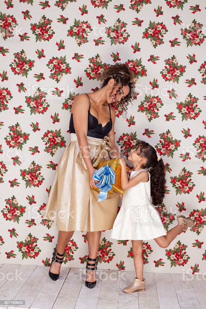 Surprising her mother with Christmas gifts stock photo