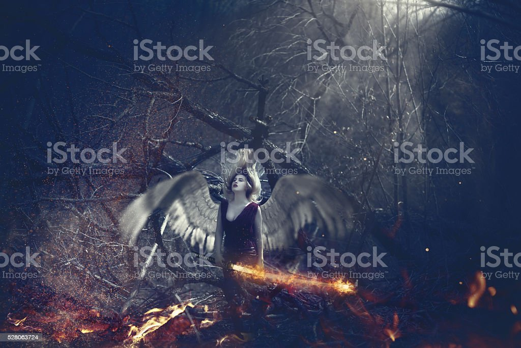 surreal angel in the woodland stock photo