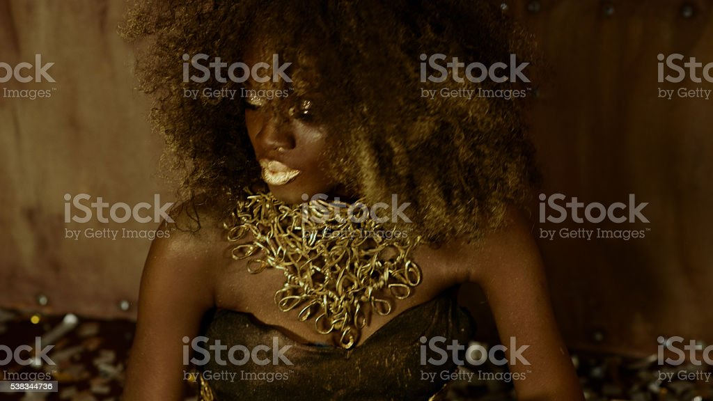 Surreal creative portrait of sexy african american female model with stock photo