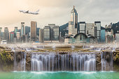 Surreal image of Huge waterfall in middle of urban city .