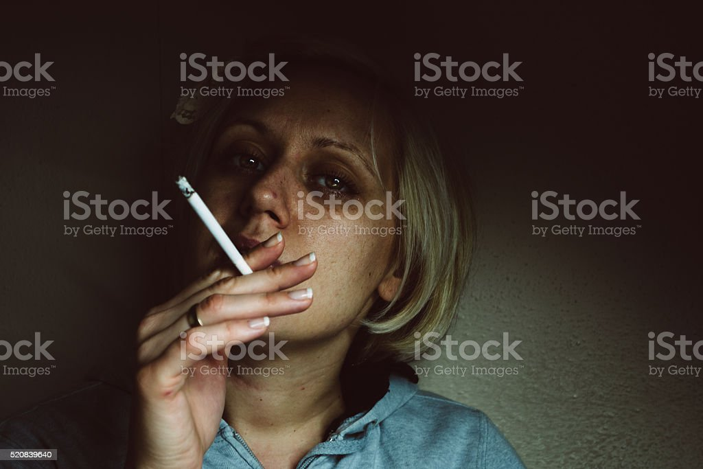 Surreal looking woman smoking stock photo