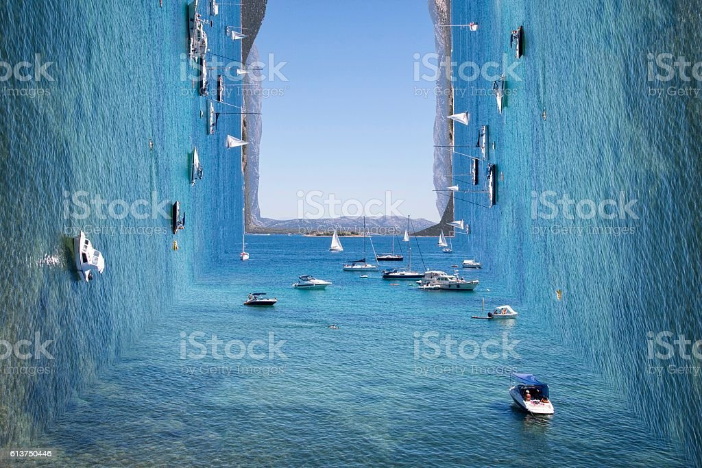Surreal view on sunny blue sea with island and boats stock photo