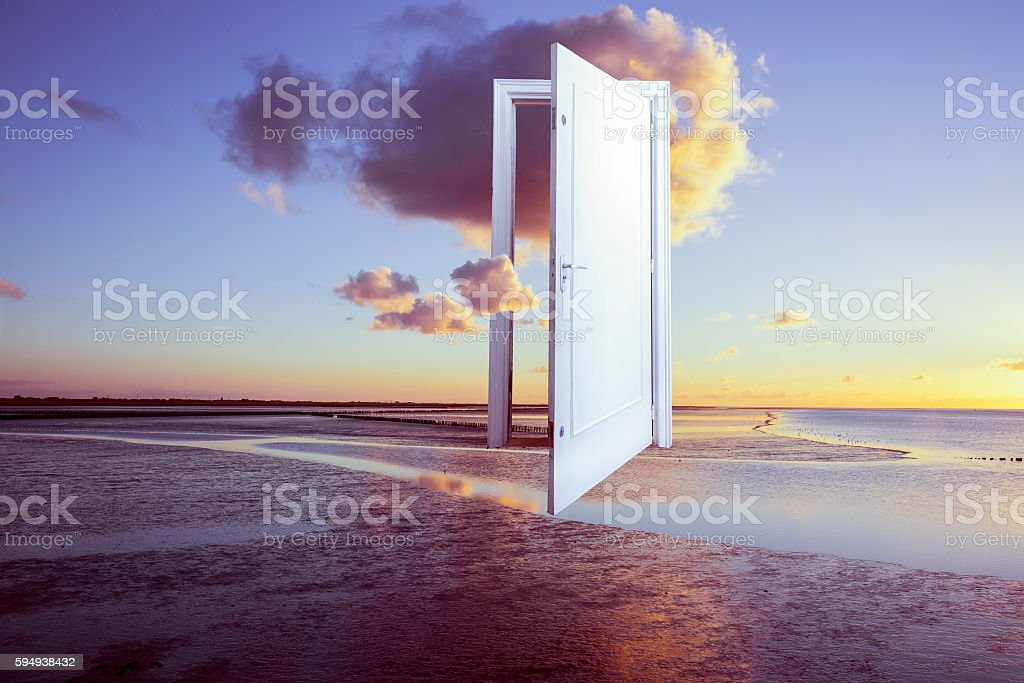 surrealistic door to freedom stock photo