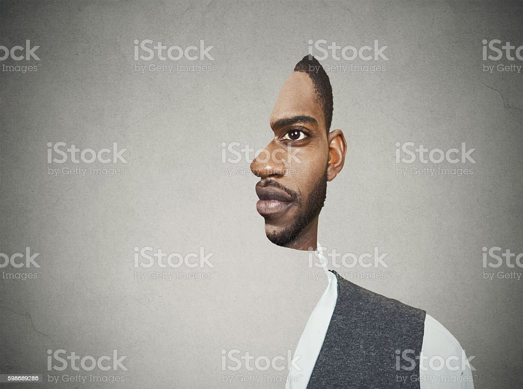 surrealistic portrait front with cut out profile of man stock photo