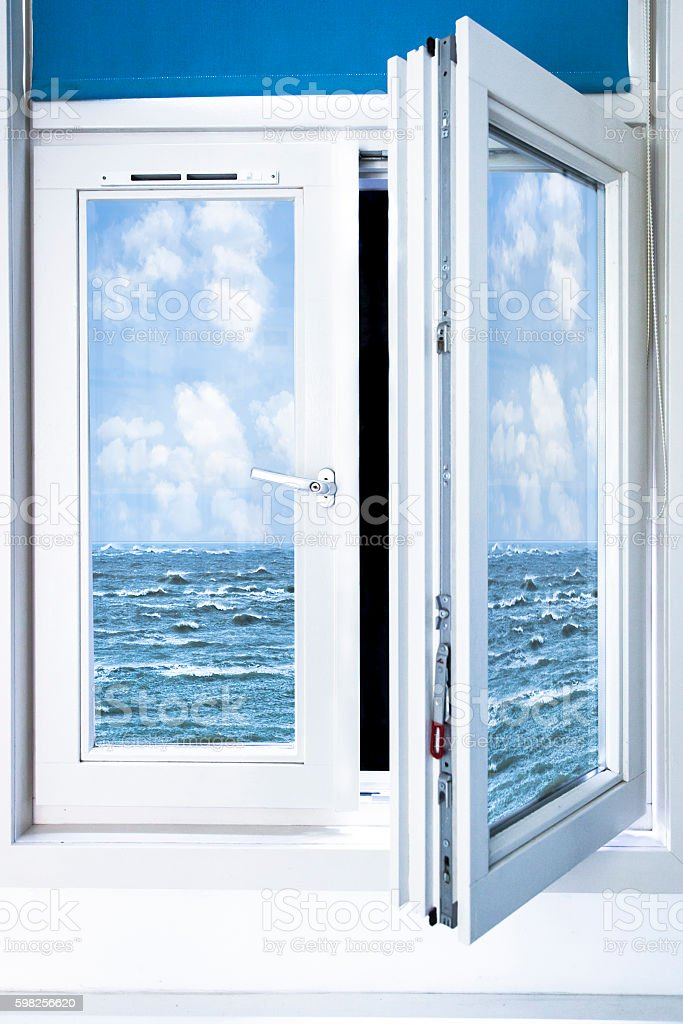 Surrealistic window open on ocean stock photo
