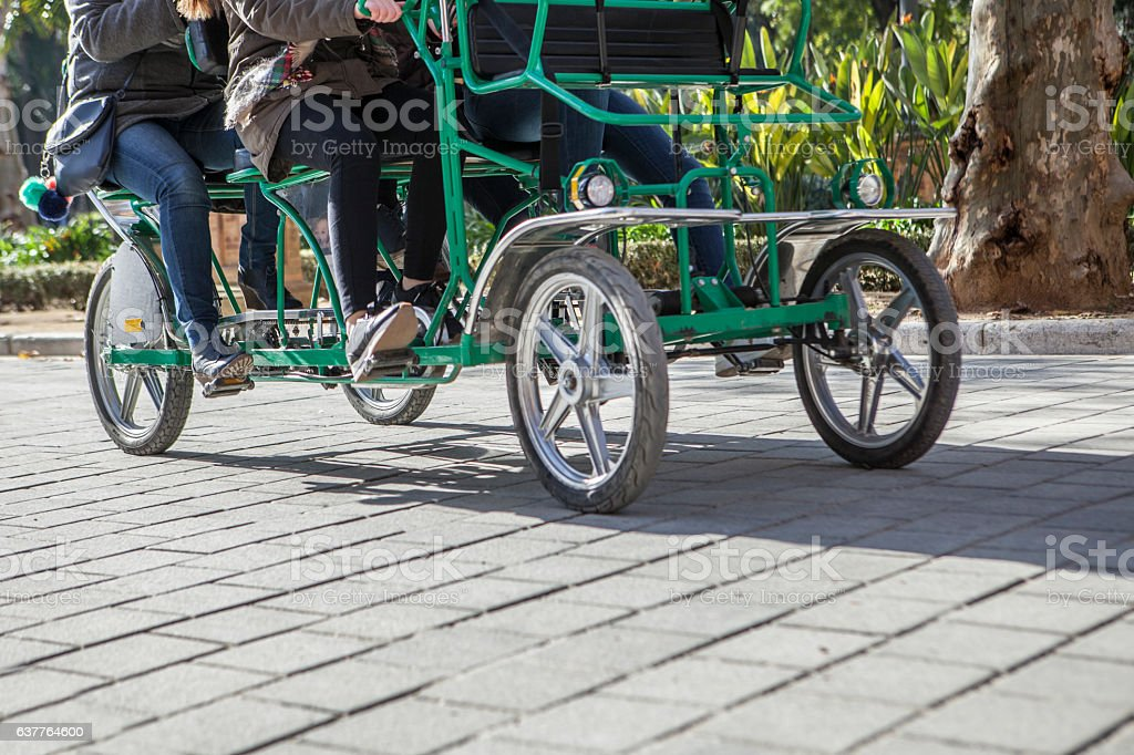 Surrey bike in motion at Plaza de Espana, Seville stock photo