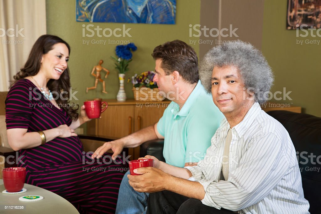 Surrogate mother with two same sex parents stock photo