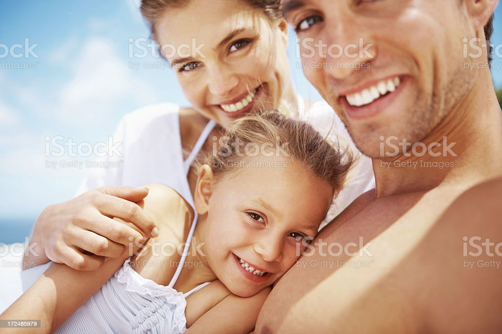 Surrounded by her parent's love royalty-free stock photo