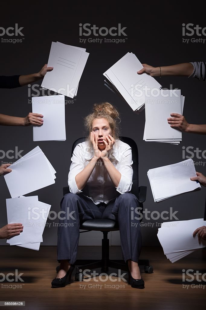 Surrounded by paperwork stock photo