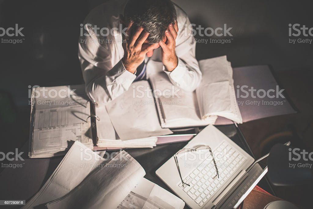 Surrounded by work stock photo