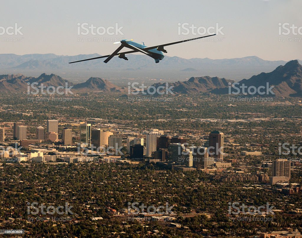 Surveiilance drone over American city stock photo