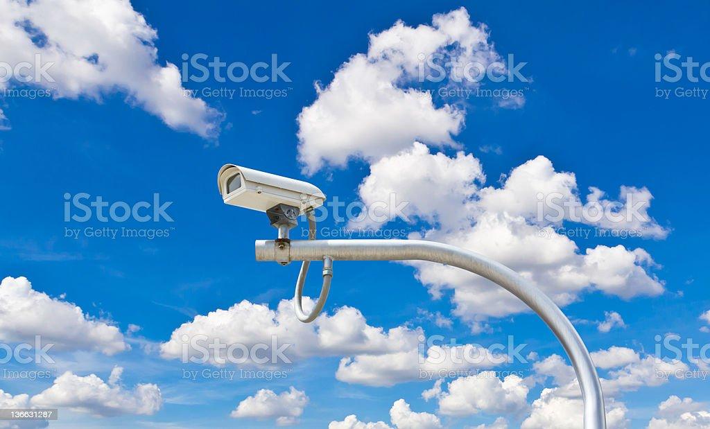 surveillance camera against blue sky royalty-free stock photo
