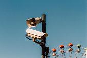 Surveillance camera and louspeaker with ferris wheel