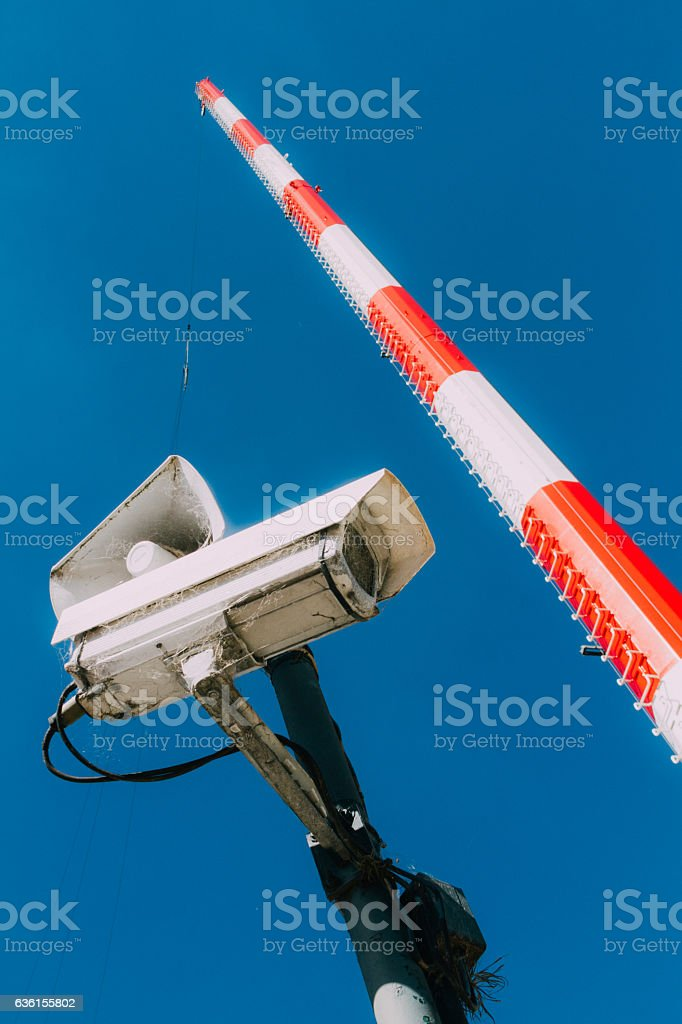Surveillance camera and louspeaker with jump tower on background stock photo