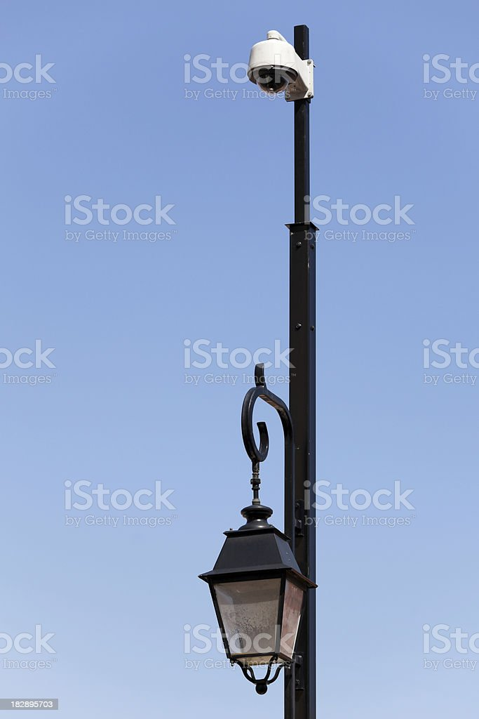 CCTV Surveillance Camera And Old Lamp On Pole stock photo
