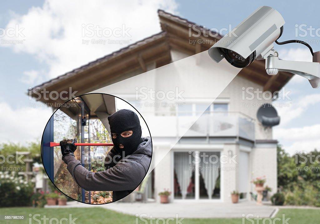 Surveillance Camera Capturing A Burglar stock photo