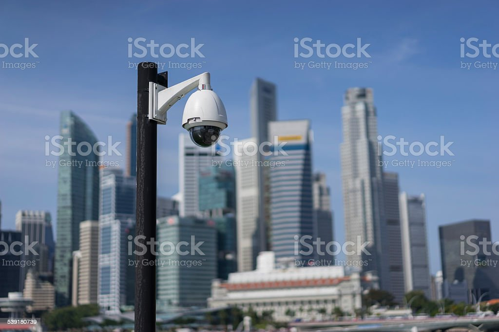 surveillance  camera in focus with Singapore CBD in background stock photo