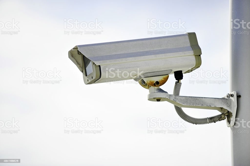 Surveillance camera on a pole stock photo