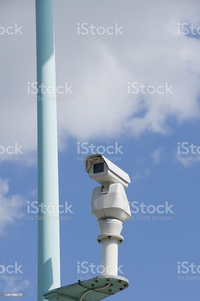 Surveillance camera on blue background royalty-free stock photo
