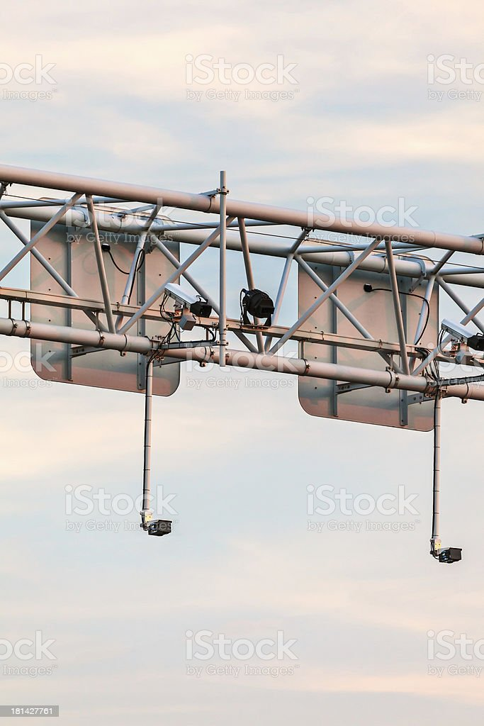 Surveillance camera system above a highway royalty-free stock photo