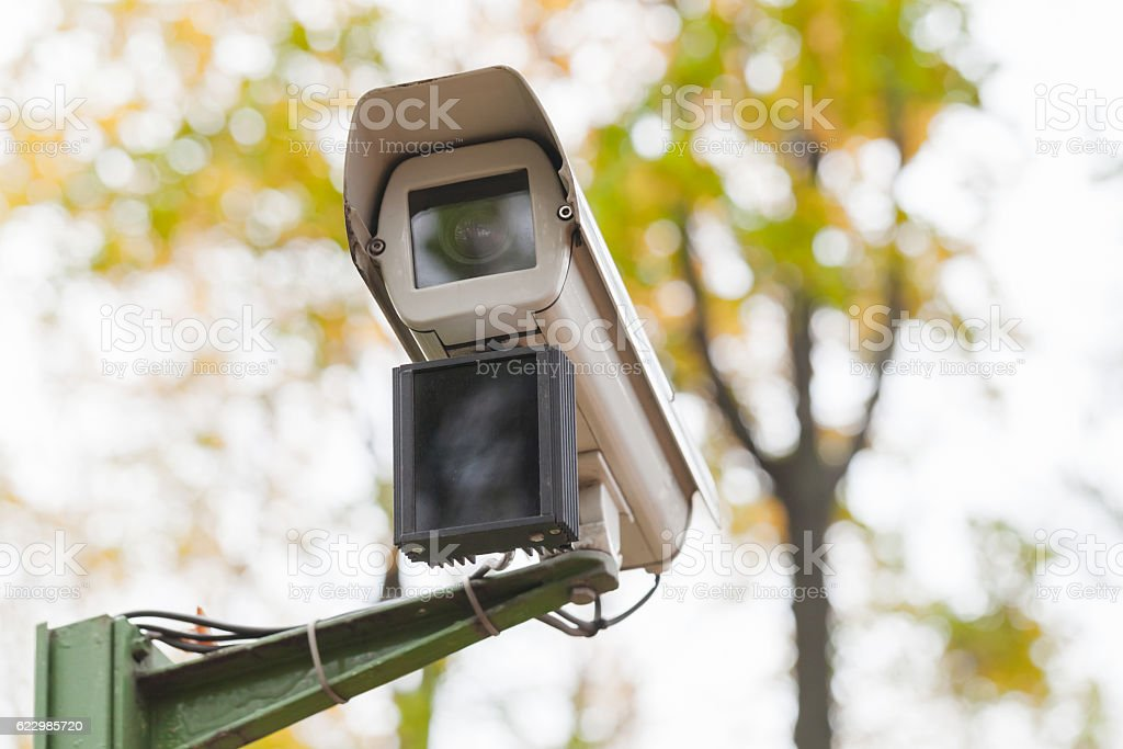 Surveillance camera with motion detector stock photo