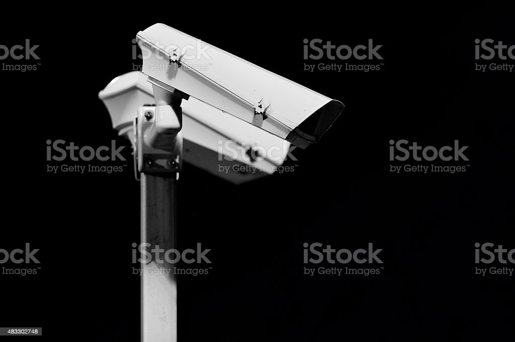 Surveillance cameras on black background stock photo