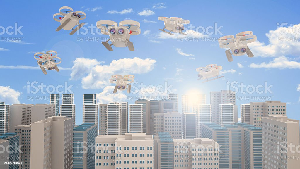 Surveillance drones flying over the city stock photo